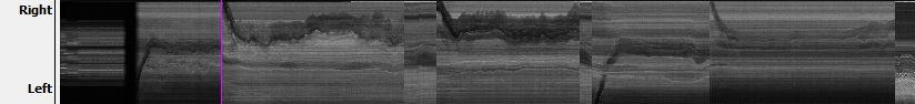 Ein Schwarz-weißes Bild zeigt am unteren Rand des Panels (linker Rand des Filmbildes) eine graue Fläche bzw. parteile grauen Schatten